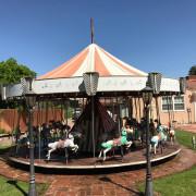 Vintage-allan-herschell-kiddie-carousel-back-yard-set-up