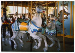 Norton photo of the Boblo Island Illions horses in the 1990 Auction Catalog.